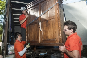 platinum removals team loading a cabinet