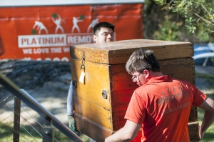 platinum removals team carrying timber box